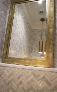 marble mosaic and gold cloakroom